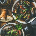 Belgian boiled mussels in tomato sauce with parsley, square crop Royalty Free Stock Photo
