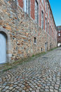 Belgian city narrow alley with old buildings in the medieval Royalty Free Stock Photography