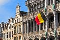 Belgian flag on the Grand Place Broodhuis in Brussels, Belgium. Royalty Free Stock Photo