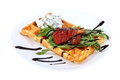 Belgian waffle with cream cheese and roasted bulgarian pepper baked bell peppers lies on a plate isolated image on white Royalty Free Stock Image