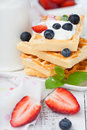 Belgian waffle delicious with fresh berries and cream for breakfast Stock Photos