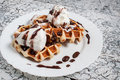 Belgian waffle with ice cream chocolate on a wooden background Stock Photos