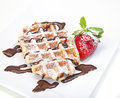 Belgian waffle with powdered sugar and chocolate syrup Royalty Free Stock Photography