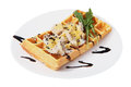 Belgian waffle with a salad of shrimp and mushrooms on the plate is the over which the champignons isolated image on white Stock Images