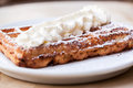 Belgian waffle with whipped cream and powdered sugar on top Royalty Free Stock Photo