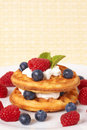 Belgian waffles with berries and cream Royalty Free Stock Photography
