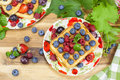 Belgian waffles and berry fruit with fresh raspberries grapes blueberries cream Stock Photos