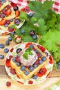 Belgian waffles and berry fruit with fresh raspberries grapes blueberries ice cream Royalty Free Stock Image
