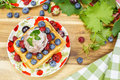 Belgian waffles and berry fruit with fresh raspberries grapes blueberries ice cream Royalty Free Stock Photography