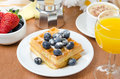 Belgian waffles with blueberries coffee and orange juice for br breakfast Stock Image