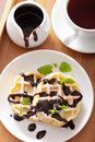 Belgian waffles with chocolate and powder sugar for breakfast Royalty Free Stock Photos