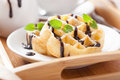 Belgian waffles with chocolate and powder sugar for breakfast Royalty Free Stock Images