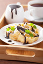 Belgian waffles with chocolate and powder sugar for breakfast Stock Photography
