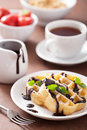 Belgian waffles with chocolate and powder sugar for breakfast Royalty Free Stock Photography