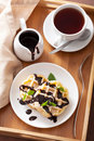 Belgian waffles with chocolate and powder sugar for breakfast on tray Stock Image