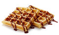 Belgian waffles with chocolate sauce isolated on white background Royalty Free Stock Photo