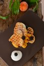 Belgian waffles with fresh peaches and ice cream Royalty Free Stock Images