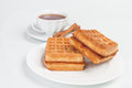 Belgian waffles fresh served on tabledesk with cup of tea Royalty Free Stock Photography