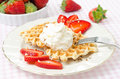 Belgian waffles with fresh strawberries and whipped cream close up Royalty Free Stock Photo
