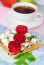 Belgian waffles with fruit jelly and fresh mint leaves on blurred background a cup of coffee Royalty Free Stock Images