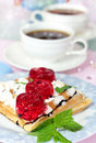 Belgian waffles with fruit jelly and fresh mint leaves on blurred background two cups of coffee Royalty Free Stock Photography