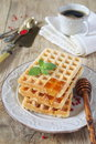 Belgian waffles with honey sweet breakfast and cup of coffee Royalty Free Stock Images