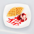 Belgian waffles with ice cream and syrup on white plate Royalty Free Stock Photos