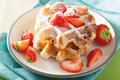 Belgian waffles with icing sugar and strawberry Royalty Free Stock Photo