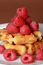 Belgian waffles and raspberries Stock Image