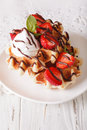 Belgian waffles with strawberries, whipped cream and chocolate c Royalty Free Stock Photo