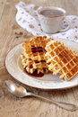 Belgian waffles with syrup and a cup of cocoa sweet breakfast Stock Photography