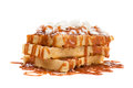 Belgian waffles waffels under the caramel topping with cream on top Royalty Free Stock Photography