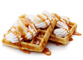 Belgian waffles with whipped cream caramel sauce and bananas isolated on white background Stock Images