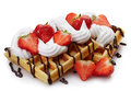 Belgian waffles with whipped cream strawberries and chocolate sauce isolated on white background Royalty Free Stock Images