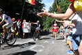 Belgium's Philippe Gilbert of the Quick-Step Floors team waves as he passes fans wishing him a happy birthday Royalty Free Stock Photo