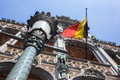 Belgium flag on grand place in brussels Royalty Free Stock Images