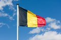 Belgium flag over a blue sky Stock Images