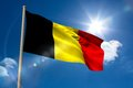 Belgium national flag on flagpole blue sky background Stock Image
