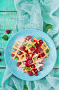 Belgium waffles with raspberries and syrup Royalty Free Stock Photo