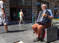 Belgrade serbia aug old man playing accordion on the street on august in city is famous for having festival of Royalty Free Stock Image
