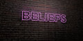 BELIEFS -Realistic Neon Sign on Brick Wall background - 3D rendered royalty free stock image Royalty Free Stock Photo