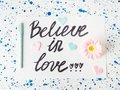 Believe in love written on white. Valentine`s day Royalty Free Stock Photo