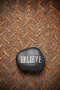 Believe rock rusty background a with the word on it with a metal Royalty Free Stock Photography