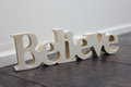 Believe wooden text the word written in wood Stock Photography