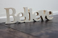 Believe wooden text the word written in wood Stock Photo