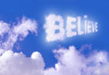 Believe the word floating high above the clouds Stock Images