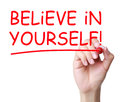 Believe in yourself hand writing with red marker on transparent wipe board Royalty Free Stock Image