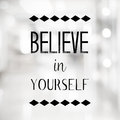 Believe in yourself quotation on blurred abstract background with bokeh light Royalty Free Stock Image