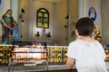 Believer kneel and praying in a catholic church old Royalty Free Stock Photo