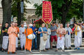Believers of the society for krishna consciousness in the center of lviv in ukraine near the opera house plays drums harmonica a Stock Photos